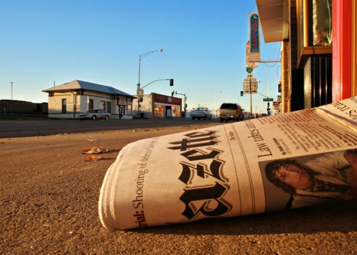 Newspaper lying on ground