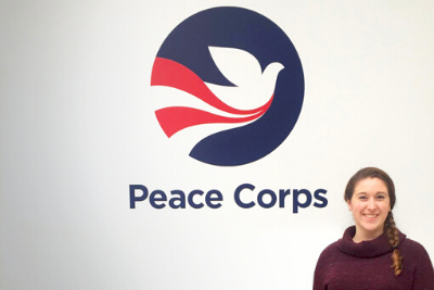 Morgan Scheinin - In front of Peace Corps sign